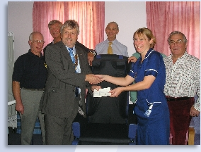 Presentation of a Hydroflex Chair, used to aid the recovery of stroke patients. The Exe Valley Rotary Club are presenting the cheque towards the purchase of one of these chairs. Another was purchased by the League of Friends.